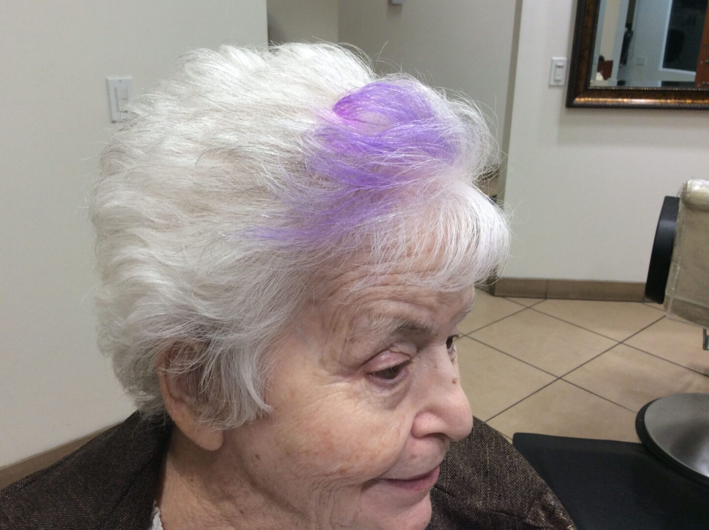 An old woman with purple highlights on her hair