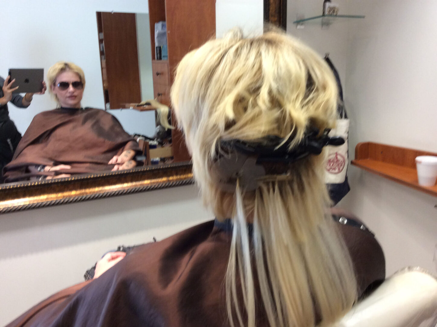 A woman getting hair extensions